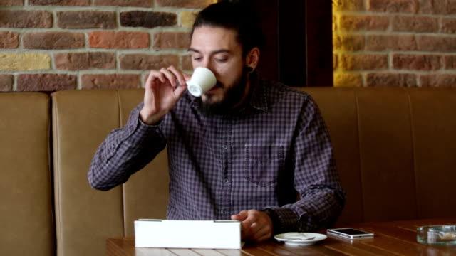 businessman working on digital tablet at cafe - metrosexual stock videos & royalty-free footage