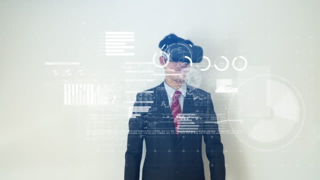 businessman working on financial data with virtual reality headset - realtà aumentata video stock e b–roll