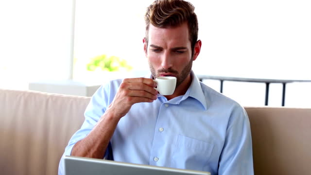 businessman working on laptop and drinking espresso - espresso stock videos & royalty-free footage