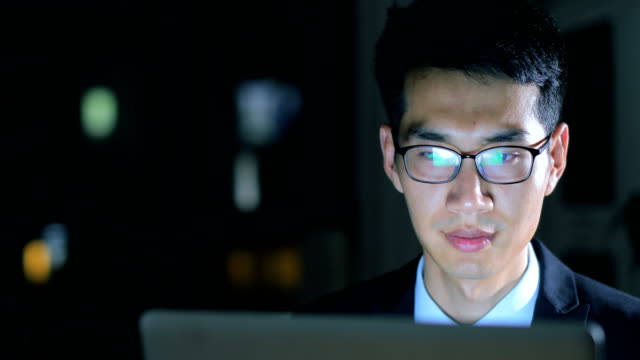 businessman working on laptop at night - technophile stock videos & royalty-free footage