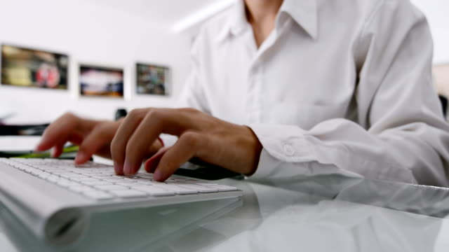 businessman working on tablet and typing on keyboard in office building - animal pen stock videos & royalty-free footage