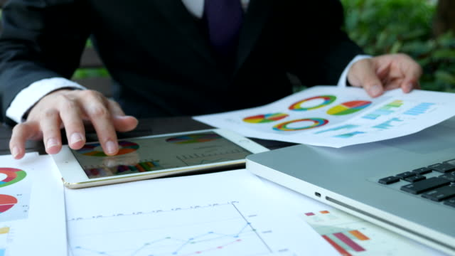 businessman working on the tablet with diagrams - risk stock videos & royalty-free footage