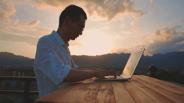 businessman working with beautiful sunset - cityscape stock videos & royalty-free footage