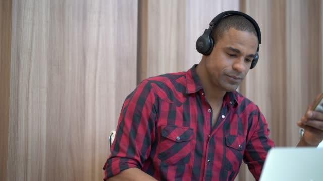 businessman working with headphones - pardo brazilian stock videos & royalty-free footage