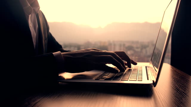 businessman working with laptop at sunset time - journalist video stock e b–roll