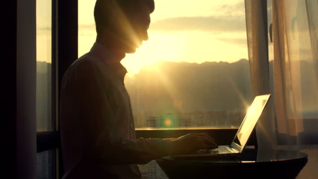 businessman working with laptop at sunset - hotel stock videos & royalty-free footage