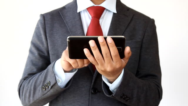 Businessman writing e-mail on mobile phone