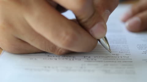 hd : businessman writing on document - form stock videos & royalty-free footage