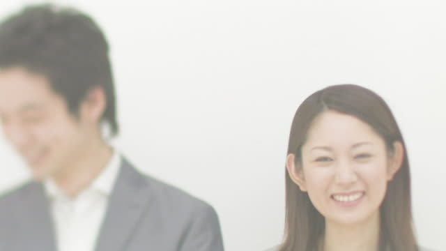 businessmen and businesswomen standing side by side smiling - only japanese stock videos & royalty-free footage