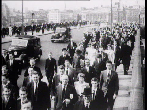 businessmen and women walk over bridge city of london 1957 - 1950 stock videos and b-roll footage