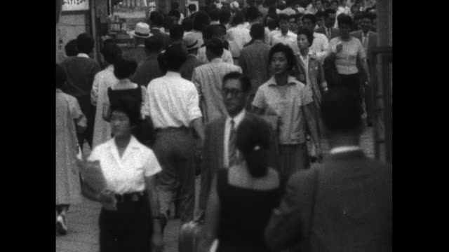 businessmen and women walking along tokyo street; 1959 - 1959 stock videos & royalty-free footage