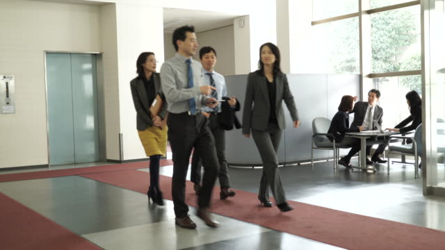businessmen and women walking and talking - staff meeting stock videos and b-roll footage