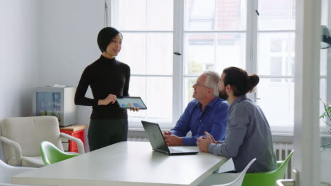 businessmen applauding the presentation of female colleague - graph stock videos & royalty-free footage