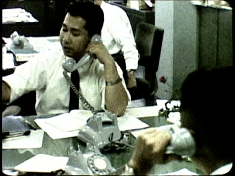 1963 MONTAGE Businessmen at work in office / Japan