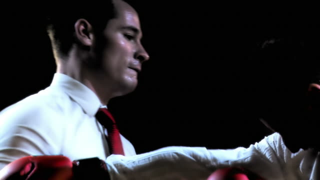 stockvideo's en b-roll-footage met hd slow-motion: businessmen boxing - all shirts