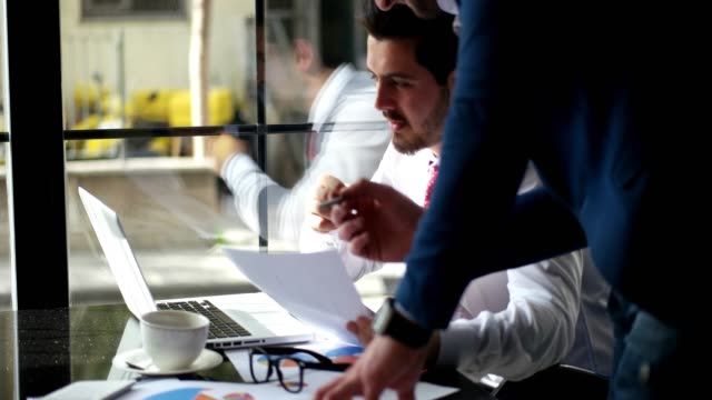 businessmen debating and discuss work plans at busy time - sharing stock videos & royalty-free footage