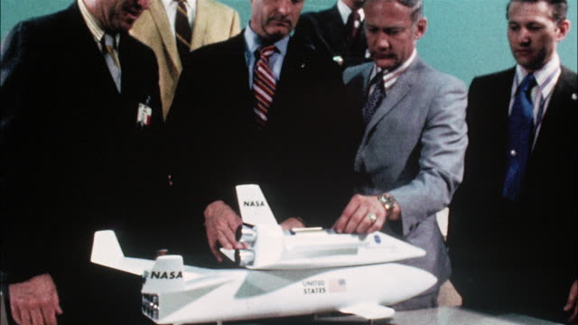 businessmen examine a model of a space shuttle piggybacked on an airplane. - model aeroplane stock videos & royalty-free footage