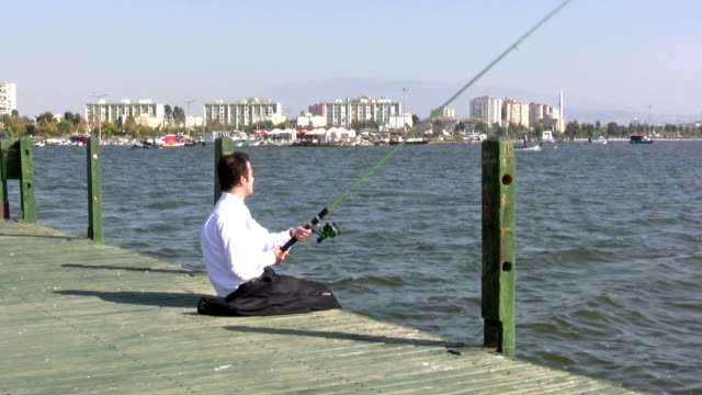 businessmen fishing on pier - one mid adult man only stock videos & royalty-free footage