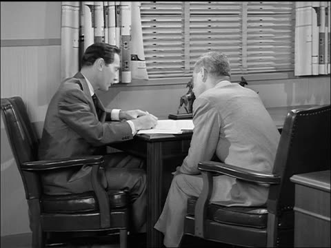 b/w 1957 2 businessmen having meeting at table in office - 1957 stock videos & royalty-free footage