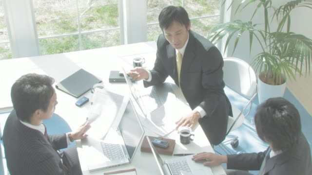 businessmen having meeting - japanese ethnicity stock videos & royalty-free footage