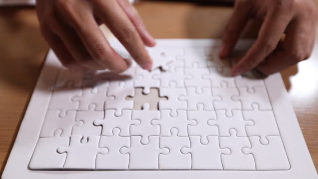 businessmen holding jigsaw puzzle ,business solutions for successful teamwork, teambuilding unity concept - solutions stock videos & royalty-free footage