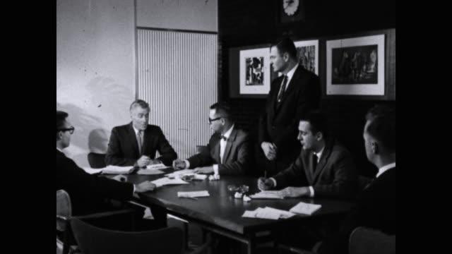 businessmen in suits having meeting in board room - mellanstor grupp av människor bildbanksvideor och videomaterial från bakom kulisserna