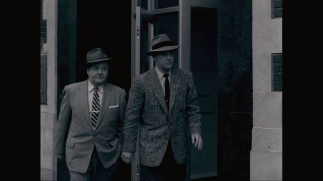 ms td ts businessmen leaving from bank / united states - cappello video stock e b–roll