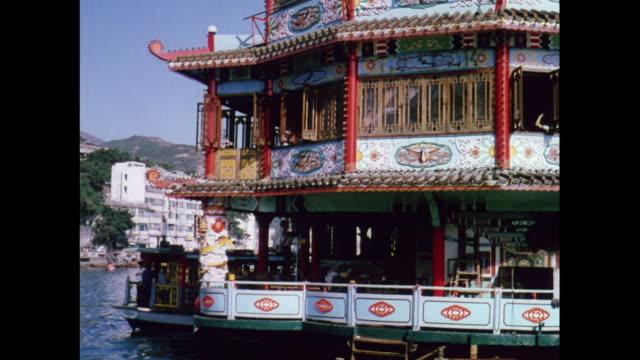 montage businessmen on a boat in aberdeen / hong kong - aberdeen hong kong stock videos & royalty-free footage