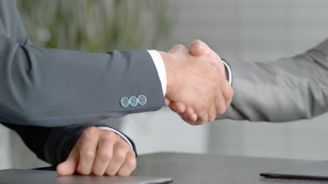 businessmen passing a signed copy to each other and shaking hands - file stock videos & royalty-free footage