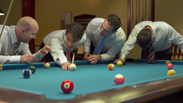hd dolly: businessmen playing eight-ball pool game - cue ball stock videos & royalty-free footage
