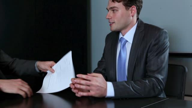 businessmen providing his resume in job interview - dokument stock-videos und b-roll-filmmaterial