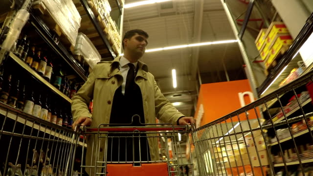 businessmen pushing shopping cart - one mid adult man only stock videos & royalty-free footage