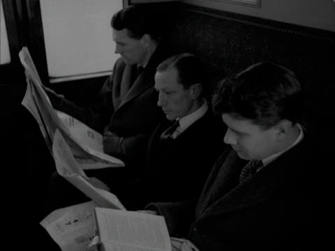 businessmen read newspapers in a railway carriage. - news not politics stock videos & royalty-free footage