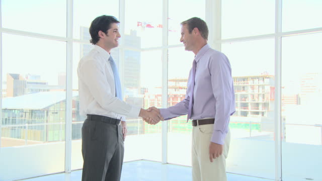 Businessmen shaking hands and talking