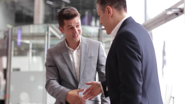 businessmen shaking hands in a corporate office - job interview stock videos and b-roll footage