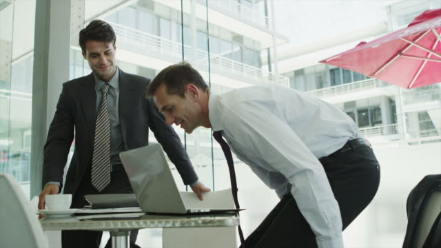 ms of businessmen shaking hands then using laptop in office - business person stock videos & royalty-free footage
