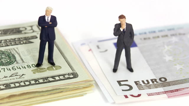 businessmen standing on dollar bills. - human representation stock videos and b-roll footage