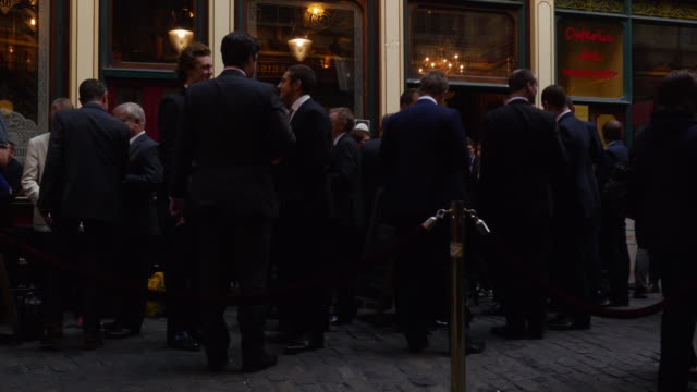 businessmen taking a break in london leadenhall market (uhd) - senior men stock videos & royalty-free footage