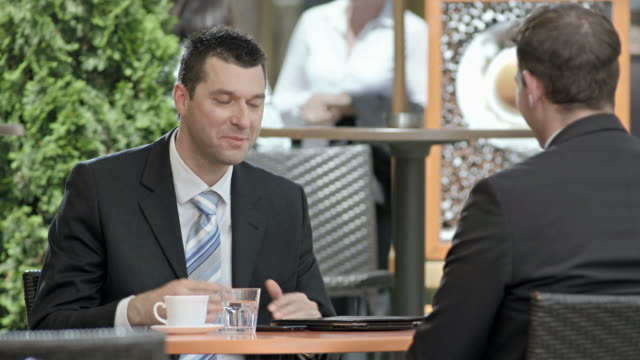 HD: Businessmen Talking During Coffee Break