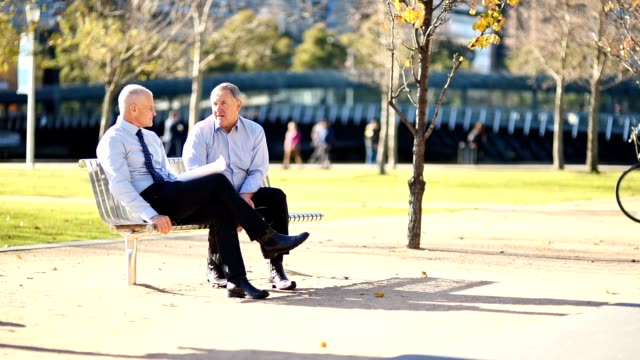 businessmen talking in the city of melbourne in a bench - park bench stock videos & royalty-free footage