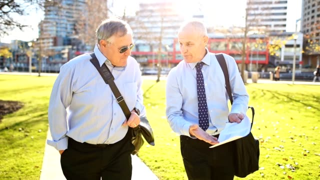 businessmen talking in the city of melbourne - park stock videos & royalty-free footage