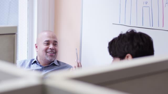 stockvideo's en b-roll-footage met businessmen using telephone then talking at office cubicles - telefoonhoorn