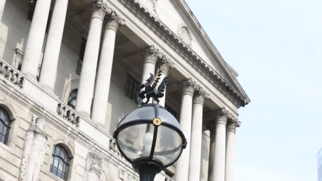 businessmen walk near the bank of england boe in the city of london uk on friday sept 27 commuters walk past the boe a city of london griffin sits on... - griffin stock videos & royalty-free footage