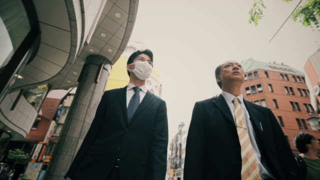 Businessmen Walking and Talking