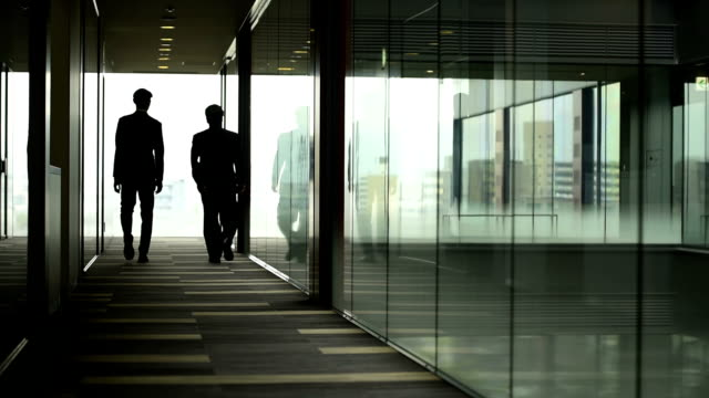 businessmen walking away from camera - business relationship stock videos & royalty-free footage