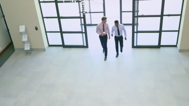 businessmen walking - building entrance stock videos & royalty-free footage