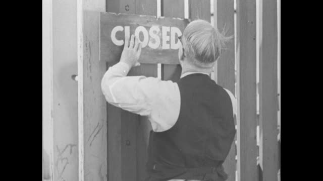 businessmen watch as stacks of coins fall factories come to a halt men turned away from work closed sign posted businesses closed crowded bank - 1929 stock videos & royalty-free footage