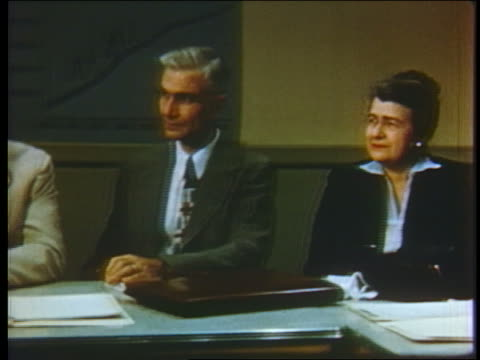 1952 pan businessmen + woman at conference table / 1 man standing reads from paper - 1952 stock videos & royalty-free footage