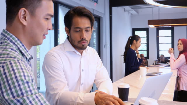 businessmen working together in an open plan office - south east asia stock videos & royalty-free footage