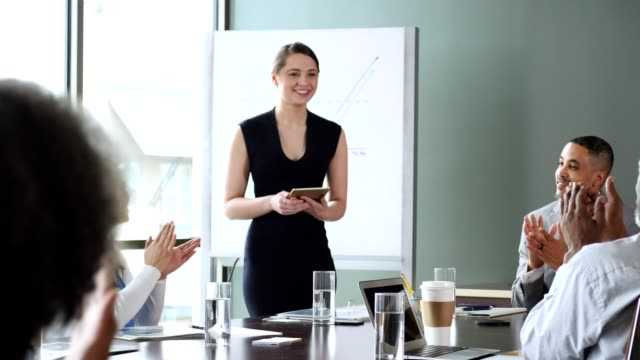 businesspeople applaud colleague after successful presentation - conference table stock videos & royalty-free footage